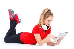 Girl listening to music on a tablet computer. Stock Image