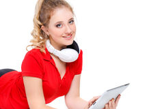 Girl listening to music on a tablet computer. Royalty Free Stock Photo