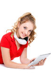 Girl listening to music on a tablet computer. Royalty Free Stock Photography
