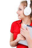 Girl listening to music on a tablet computer. Royalty Free Stock Photos