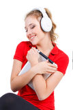 Girl listening to music on a tablet computer. Royalty Free Stock Images