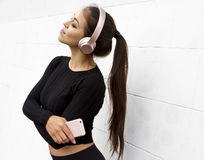 Girl listening to music on white background Royalty Free Stock Images