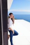Girl listening to the music on white headphones Stock Image