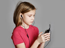Girl listening to music on your phone royalty free stock images