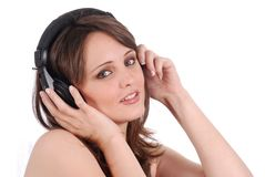 Girl listening to musicthrough headphones isolated Royalty Free Stock Image