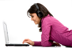 Girl listening to online music Stock Photography