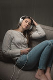 Girl listening to relaxing music Royalty Free Stock Photography