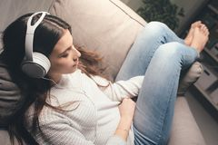 Girl listening to relaxing music Stock Photo