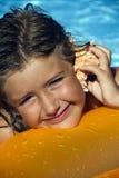 Girl listening to sea shell Stock Photo