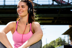 Girl listening to some music. urban lifestyle. Urban girl listening to some music. city style Royalty Free Stock Image