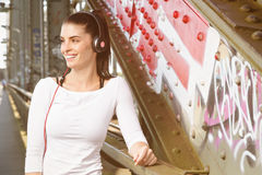 Girl listening to some music. urban lifestyle. Urban girl listening to some music. city style stock image