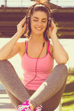 Girl listening to some music. urban lifestyle. color edit. Urban girl listening to some music. city style Royalty Free Stock Images