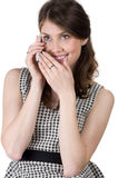 Girl listening to something nice on the phone Stock Images