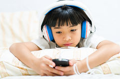 Girl listens the music. Royalty Free Stock Photography