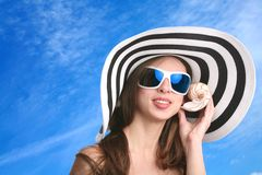Girl listens seashell Stock Photos