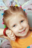 Girl listens ticking of watch. Small girl rejoices to new watch- listen their ticking Stock Image