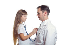 The girl listens to the doctor a stethoscope Royalty Free Stock Photos
