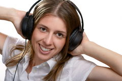 The girl listens to music Royalty Free Stock Images