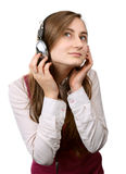 A girl listens to music Royalty Free Stock Images