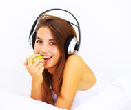 Girl listens to music Stock Photography