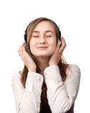 A girl listens to music Stock Image