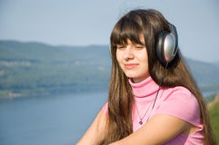 A girl listens to music Royalty Free Stock Photo