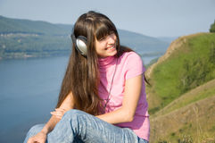 A girl listens to music Stock Photo
