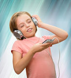 Girl listens to music. Stock Images