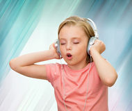 Girl listens to music. Stock Photography