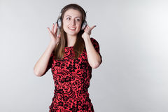 Girl listens to music with headphones and dancing Stock Photography