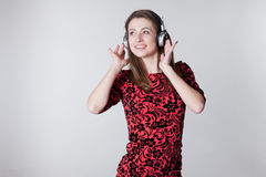 Girl listens to music with headphones and dancing Stock Photos