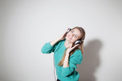 Girl listens to music with headphones Stock Photography