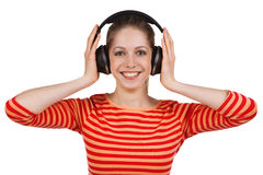 Girl listens to music on headphones Royalty Free Stock Photography