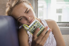 Girl listens to music of  train Stock Images