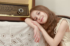 Girl Listens to the radio Royalty Free Stock Photo