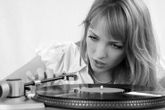 The girl listens to a vinylic disk Royalty Free Stock Image