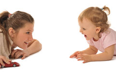 Girl with little baby in studio are playing Royalty Free Stock Photo
