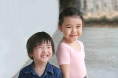 Girl & little boy Stock Photos