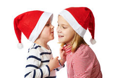 Girl and little boy in Santa Claus hat Royalty Free Stock Images