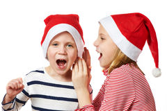 Girl and little boy in Santa Claus hat Stock Photos