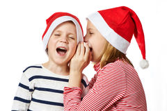 Girl and little boy in Santa Claus hat Royalty Free Stock Photos