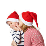 Girl and little boy in Santa Claus hat Stock Photo