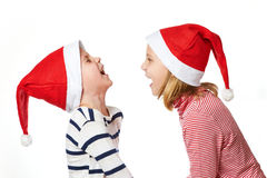 Girl and little boy in Santa Claus hat Royalty Free Stock Photography