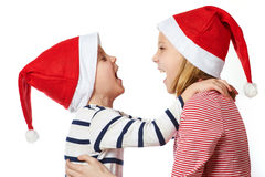 Girl and little boy in Santa Claus hat Royalty Free Stock Photo