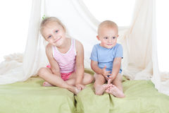 Girl with little brother Stock Images