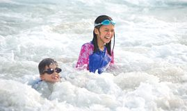 girl and little brother having fun in the sea Royalty Free Stock Photography