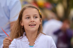 Smile Girl. Little cheerful girl looks into the distance emotionally Royalty Free Stock Photography