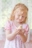 Girl with little chicken Royalty Free Stock Photos