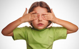 Girl little child teenager covering her face Royalty Free Stock Photography