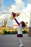 Girl. The little curly-haired girl holding a teddy bear Royalty Free Stock Photos
